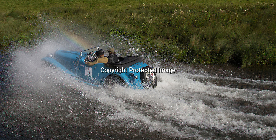 14/06/16<br /> <br /> A rainbow frames Charles Andrews and Francesca Mazzacurati in a 1938 AC 16/18 March.<br /> <br /> Competitors in the Royal Automobile Club 1000 Mile Trial splash through Tissington Ford near Ashbourne in the Derbyshire Peak District. The rally saw 43 pre-war cars leave Edinburgh on Monday and finishes in Dorking, Surrey on Saturday.<br /> All Rights Reserved, F Stop Press Ltd.