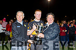 Austin Stacks captain Barry Walsh receives the Tommy Barrett Memorial cup from Christy Killeen (Kerry Co Comm) and Eddie Barrett after their win over Annascaul in the Barrett Cup final
