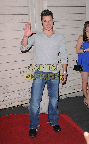 NICK LACHEY.attends The Maxim's 2008 Hot 100 Party held at Paramount Studios in Hollywood, California, USA, May 21st 2008.                                                                     full length grey top gray hand waving jeans.CAP/DVS.©Debbie VanStory/Capital Pictures