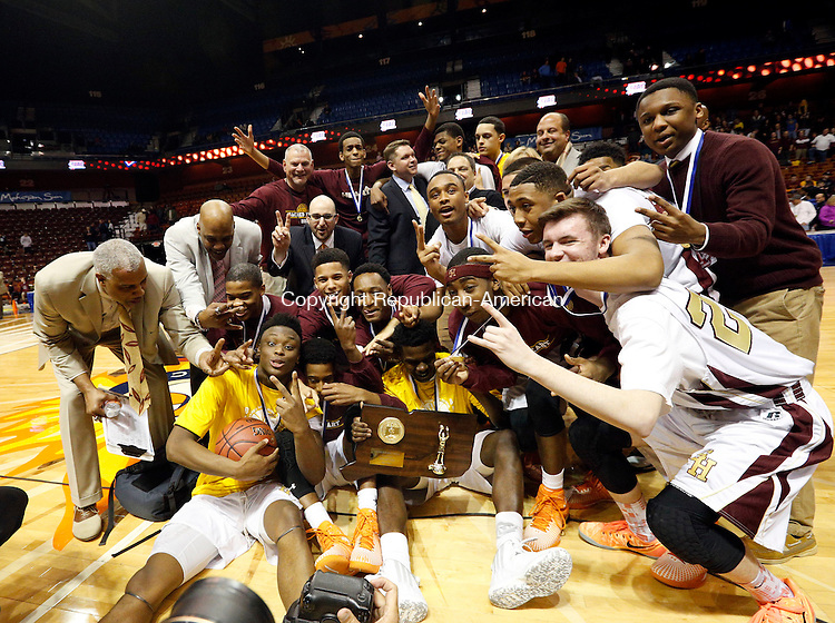 Uncasville, CT- 22 March 2015-032215CM36- Sacred Heart boys basketball team celebrates after the Hearts defeated Valley Regional in Class S state championship game at Mohegan Sun Arena in Uncasville on Sunday. The Hearts won, 71-46.    Christopher Massa Republican-American