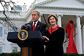 United States President George W. Bush, accompanied by first lady Laura Bush, delivers remarks on World Aids Day on the North Lawn of the White House in Washington, D.C., Monday, December 1, 2008.<br /> Credit: Mannie Garcia / Pool via CNP