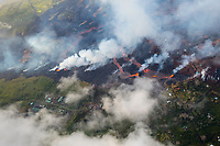 May 2018: An aerial view of lava approaching Puna Geothermal Venture and other structures in Leilani Estates, Puna, Big Island of Hawai'i.