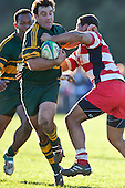 Armyn Sanders breaks past August Pulu. Counties Manukau Premier Club Rugby semi final game between Pukekohe and Karaka, played at Colin Lawrie Fields Pukekohe on Saturday July 10th 2010.Pukekohe won 44 - 20 and will meet Waiuku in next weeks final at Growers Stadium.