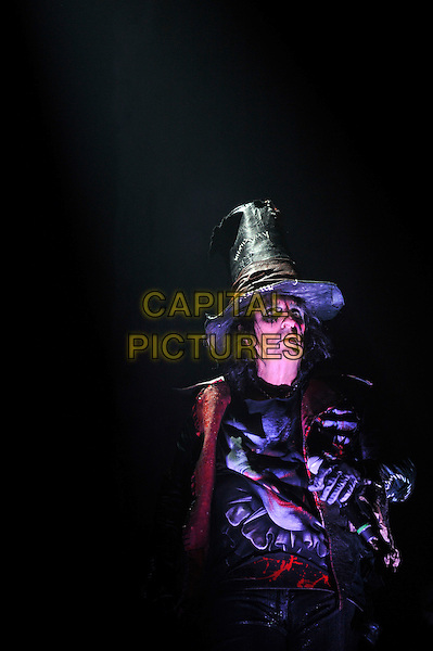 Alice Cooper.Performing live in concert, Wembley Arena, London, England. .28th October 2012.on stage in concert live gig performance performing music half length black shirt hat witch.CAP/MAR.© Martin Harris/Capital Pictures.