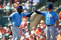 Tampa Bay Rays right fielder Guillermo Heredia (54) is congratulated by Jason Coats (31) after hitting a home run in the top of the first inning during a Grapefruit League Spring Training game against the Baltimore Orioles on March 1, 2019 at Ed Smith Stadium in Sarasota, Florida.  Rays defeated the Orioles 10-5.  (Mike Janes/Four Seam Images)