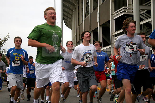 Participants in the 2012 Dance Blue 5K at Commonwealth Stadium in Lexington, Ky., on Sunday, October 14, 2012. Photo by Adam Pennavaria | Staff
