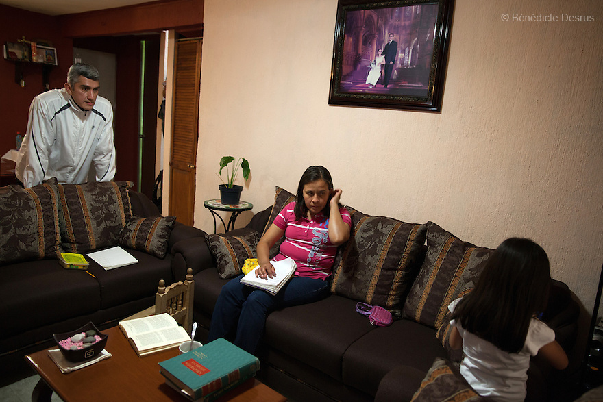 """Donovan's daughter plays while he and his wife look on, at their home in Texcoco, Mexico on May 21, 2015. Donovan Tavera, 43, is the director of """"Limpieza Forense México"""", the country's first and so far the only government-accredited forensic cleaning company. Since 2000, Tavera, a self-taught forensic technician, and his family have offered services to clean up homicides, unattended death, suicides, the homes of compulsive hoarders and houses destroyed by fire or flooding. Despite rising violence that has left 70,000 people dead and 23,000 disappeared since 2006, Mexico has only one certified forensic cleaner. As a consequence, the biological hazards associated with crime scenes are going unchecked all around the country. Photo by Bénédicte Desrus"""