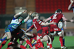 Scarlets scrum half Aled Davies kicks the ball away from the breakdown under pressure from Connacht flanker Jonny O'Connor..Scarlets v Connacht.Parc y Scarlets.Rabo Pro12.08.02.13.©Steve Pope-SPORTINGWALES