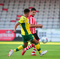 Lincoln City's Tom Pett vies for possession with Norwich City's Ben Godfrey<br /> <br /> Photographer Andrew Vaughan/CameraSport<br /> <br /> Football Pre-Season Friendly - Lincoln City v Norwich City - Tuesday 10th July 2018 - Sincil Bank - Lincoln<br /> <br /> World Copyright &copy; 2018 CameraSport. All rights reserved. 43 Linden Ave. Countesthorpe. Leicester. England. LE8 5PG - Tel: +44 (0) 116 277 4147 - admin@camerasport.com - www.camerasport.com