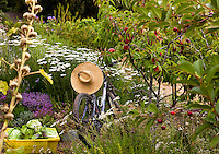 Farmer's sun hat on bicycle in organic garden