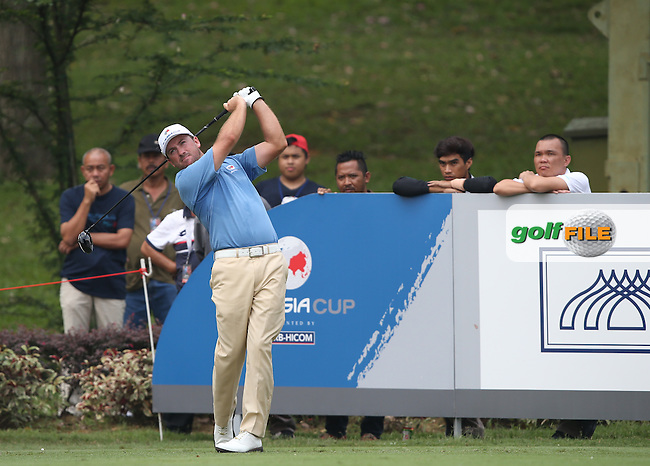 Team Europe's Graeme McDowell (NIR)  drives down the 8th needing some good fortune to claw back 3 strokes during the first day Foursomes at the 2014 Eurasia Cup presented by DRB-Hicom, at the Glenmarie Golf & Country Club, Kuala Lumpur, Malaysia. Picture:  David Lloyd / www.golffile.ie