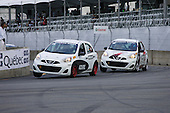 Two Nissan Micras at turn 1  for  the Nissan Micra Cup challenge held during the GP3R weekend in Three-Rivers, Quebec