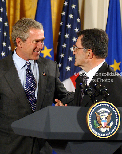 United States President George W. Bush, left, and European Commission President Romano Prodi, right, share some thoughts as they prepare to depart following their joint press conference with Prime Minister Constantine Simitis of Greece, the current European Union (EU) President,  in the East Room at the White House in Washington, DC on June 25, 2003..Credit: Ron Sachs / CNP