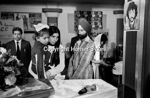 Blair Peach funeral and lying in state. Southall west London 1979. Photograph of Blair Peach on the column above his coffin.  The Dominion Cinema where his lying in state took place was visited by 8,000 Sikhs on the eve of his funeral.