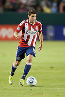 Chivas midfielder Sal Zizzo (15) move the ball up the field during the second half of the game between Chivas USA and the New England Revolution at the Home Depot Center in Carson, CA, on September 10, 2010. Chivas USA 2, New England Revolution 0.