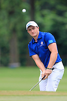Paul Dunne (Europe) chipping onto the 16th green during the Singles Matches of the Eurasia Cup at Glenmarie Golf and Country Club on the Sunday 14th January 2018.<br /> Picture:  Thos Caffrey / www.golffile.ie