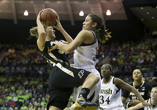December 29, 2012:  Purdue forward Sam Ostarello (32) goes up for a shot as Notre Dame forward Natalie Achonwa (11) defends during NCAA Women's Basketball game action between the Notre Dame Fighting Irish and the Purdue Boilermakers at Purcell Pavilion at the Joyce Center in South Bend, Indiana.  Notre Dame defeated Purdue 74-47.