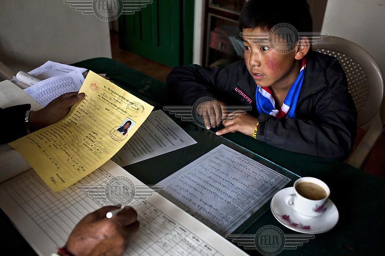 An official registers a newly arrived Tibetan refugee at the Tibetan Reception Centre.