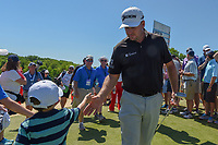 Graeme McDowell (NIR) shakes hands with young fans as he approaches 10 during round 1 of the AT&T Byron Nelson, Trinity Forest Golf Club, at Dallas, Texas, USA. 5/17/2018.<br /> Picture: Golffile | Ken Murray<br /> <br /> <br /> All photo usage must carry mandatory copyright credit (© Golffile | Ken Murray)