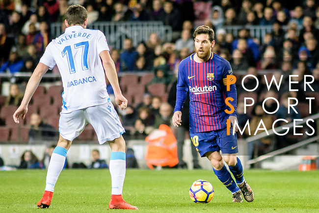 Lionel Messi of FC Barcelona (R) competes for the ball with Federico Valverde Dipetta of RC Deportivo La Coruna (L) during the La Liga 2017-18 match between FC Barcelona and Deportivo La Coruna at Camp Nou Stadium on 17 December 2017 in Barcelona, Spain. Photo by Vicens Gimenez / Power Sport Images