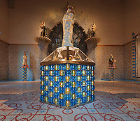 Display of the Madonna's jewels and statue of Virgin and child with base of blue and gold glass beads by Murano glassmaker Salviati, in the Bell tower room themed 'Le Merveilleux' or The Supernatural, first floor, in Le Tresor de la Cathedral d'Angouleme, in Angouleme Cathedral, or the Cathedrale Saint-Pierre d'Angouleme, Angouleme, Charente, France. The 12th century Romanesque cathedral was largely reworked by Paul Abadie in 1852-75. In 2008, Jean-Michel Othoniel was commissioned by DRAC Aquitaine - Limousin - Poitou-Charentes to display the Treasure of the Cathedral in some of its rooms, which opened to the public on 30th September 2016. The cement floor tiles made by MiraColour and the hand printed wallpaper by Atelier d'Offard, both use interlacing patterns reminiscent of the Neo-Romanesque period of the 19th century. Picture by Manuel Cohen. L'autorisation de reproduire cette oeuvre doit etre demandee aupres de l'ADAGP/Permission to reproduce this work of art must be obtained from DACS.