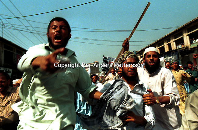 Demonstrators shouting anti- US slogans at a pro-Taleban demonstration on October 6, 2001 in the old town in Peshawar, Pakistan. The demonstration was held to support Osama Bin Laden and the Taleban movement in Afghanistan..Photo: Per-Anders Pettersson/Grazia Neri...
