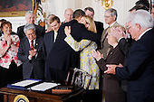 United States President Barack Obama hugs Sarah Wade, wife of Ted Wade after signing the Caregivers and Veterans Omnibus Health Services Act, which improve health care services for veterans and expand caregiver benefits and training in the State Dining Room of the White House in Washington, DC, on Wednesday, May 5, 2010..Credit: Olivier Douliery / Pool via CNP