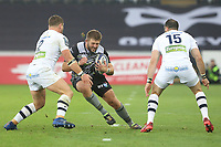 Scott Otten of Ospreys is tackled by Benjamin Kayser of Clermont during the Champions Cup Round 1 match between Ospreys and Clermont at The Liberty Stadium, Swansea, Wales, UK. Sunday 15 October 2017