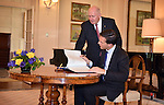 AUSTRALIA, Canberra : Australian Governor-General Peter Cosgrove (L) assists as the Netherlands Prime Minister Mark Rutte (R) signs the visitors book at Government House in Canberra on November 6, 2014. AFP PHOTO/POOL Mark GRAHAM