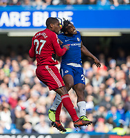 Christian Kabasele of Watford & Michy Batshuayi of Chelsea during the Premier League match between Chelsea and Watford at Stamford Bridge, London, England on 21 October 2017. Photo by Andy Rowland.