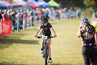 NWA Democrat-Gazette/CHARLIE KAIJO Cate Mertins of Haas Hall Academy crosses the finish line during the girls JV race at the John Brown University Sager Creek Trail in Siloam Springs, AR on Sunday, September 10, 2017. The first race of the 2017 Arkansas NICA Season took place at Sager Creek Trail on the campus of John Brown University in Siloam Springs, Arkansas.