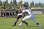 Palos Verdes CA 10/22/10 - Okuoma Idah (Peninsula #24) and Devin Christy (Leuzinger #5) in action during the Leuzinger - Peninsula varsity football game at Palos Verdes Peninsula High School.