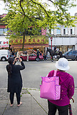 CANADA, Vancouver, British Columbia, the ladies take pictures of the Royal Canadian Mounted Police stopping a man in his car in China Town