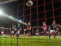 Dundee Utd's Jaroslaw Fojut scores United's late winner.