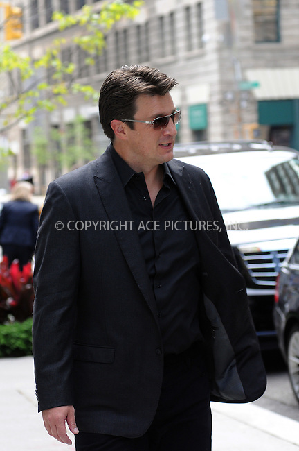 WWW.ACEPIXS.COM . . . . .  ....May 4 2012, New York City....Actor Nathan Fillion walks in Midtown Manhattan on May 4 2012 in New York City....Please byline: CURTIS MEANS - ACE PICTURES.... *** ***..Ace Pictures, Inc:  ..Philip Vaughan (212) 243-8787 or (646) 769 0430..e-mail: info@acepixs.com..web: http://www.acepixs.com