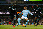 Raheem Sterling of Manchester City goes down and claims a penalty against Arthur Masuaka of West Ham United during the premier league match at the Etihad Stadium, Manchester. Picture date 3rd December 2017. Picture credit should read: Andrew Yates/Sportimage