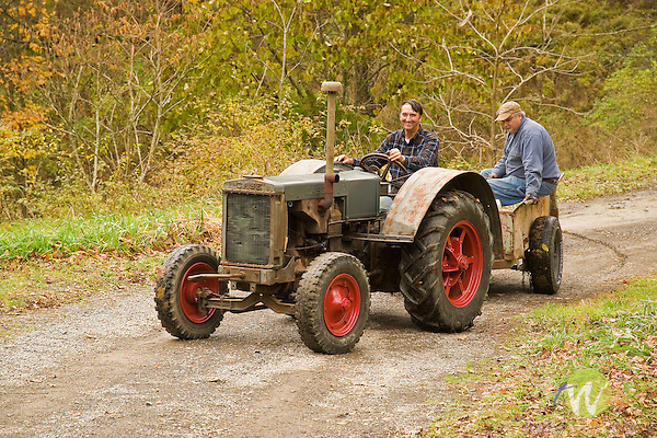 Bonnie and Galin Ingram. Apple butter making party. Kepner Road, Muncy, PA. Galin and friend with old case tractor.