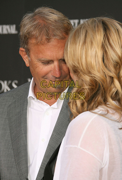 "KEVIN COSTNER & CHRISTINE BAUMGARTNER.""Mr. Brooks"" Los Angeles Premiere at Grauman's Chinese Theatre, Hollywood, California, USA..May 22nd, 2007.headshot portrait grey gray suit jacket white black soul patch facial hair married husband wife couple looking down.CAP/ADM/RE.©Russ Elliot/AdMedia/Capital Pictures"