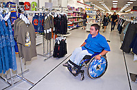 Wheelchair user shopping. This image may only be used to portray the subject in a positive manner..©shoutpictures.com..john@shoutpictures.com