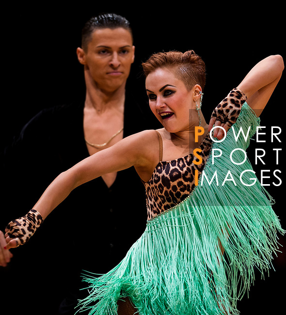 Marius-Andrei Balan and Nina Bezzubova of Germany during the WDSF GrandSlam Latin on the Day 1 of the WDSF GrandSlam Hong Kong 2014 on May 31, 2014 at the Queen Elizabeth Stadium Arena in Hong Kong, China. Photo by AItor Alcalde / Power Sport Images