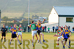 Gavin Crowley from Kenmare in the air with St Michaels/Foilmore's Damien Kelly  breaks down this high ball to the waiting Brian Crowley.