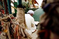 A man is praying at a Sufi-Shrine near Chenepir in the desert of Cholistan.<br /> The people came from far away for praying at the shrine.<br /> 16.2.2001, Chenepir/Punjab<br /> Copyright: Christian-Ditsch.de<br /> [Inhaltsveraendernde Manipulation des Fotos nur nach ausdruecklicher Genehmigung des Fotografen. Vereinbarungen ueber Abtretung von Persoenlichkeitsrechten/Model Release der abgebildeten Person/Personen liegen nicht vor. NO MODEL RELEASE! Nur fuer Redaktionelle Zwecke. Don't publish without copyright Christian-Ditsch.de, Veroeffentlichung nur mit Fotografennennung, sowie gegen Honorar, MwSt. und Beleg. Konto: I N G - D i B a, IBAN DE58500105175400192269, BIC INGDDEFFXXX, Kontakt: post@christian-ditsch.de<br /> Bei der Bearbeitung der Dateiinformationen darf die Urheberkennzeichnung in den EXIF- und  IPTC-Daten nicht entfernt werden, diese sind in digitalen Medien nach §95c UrhG rechtlich geschuetzt. Der Urhebervermerk wird gemaess §13 UrhG verlangt.]