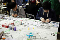 "Visitors enjoy constructing scale model toys during the Niconico Douga fan event at Makuhari Messe International Exhibition Hall on April 25, 2015, Chiba, Japan. The event includes special attractions such as J-pop concerts, Sumo and Pro Wrestling matches, cosplay and manga and various robot performances and is broadcast live on via the video-sharing site. Niconico Douga (in English ""Smiley, Smiley Video"") is one of Japan's biggest video community sites where users can upload, view, share videos and write comments directly in real time, creating a sense of a shared watching. According to the organizers more than 200,000 viewers for two days will see the event by internet. The popular event is held in all 11 halls of the huge Makuhari Messe exhibition center from April 25 to 26. (Photo by Rodrigo Reyes Marin/AFLO)"