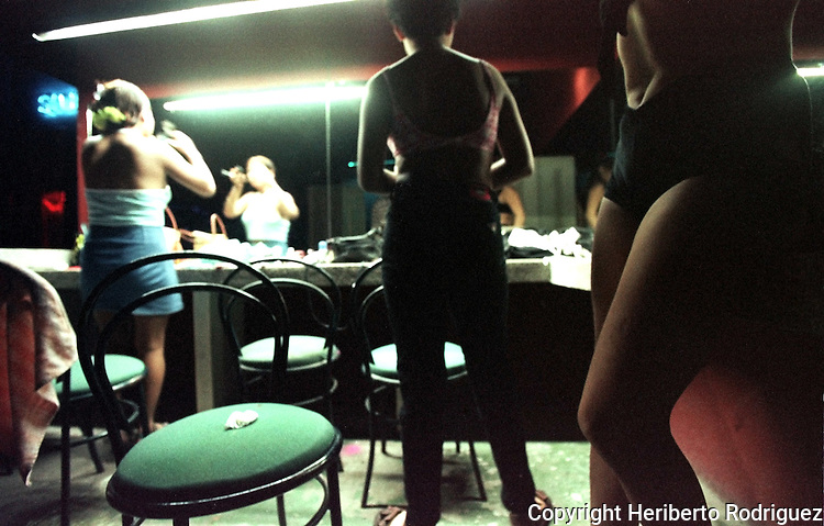 Table dancers make up in a night club dressing room in touristic Huatulco town, in southern state of Oaxaca.  Photo by Heriberto Rodriguez