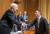 Dr. Michael Faulkender, professor of finance and associate dean of masters programs at the University of Maryland's Robert H. Smith School of Business, right, shakes hands with United States Senator Orrin Hatch (Republican of Utah), left, after giving testimony before the US Senate Committee on Finance on his nomination as Assistant Secretary of the Treasury for Economic Policy on Capitol Hill in Washington, DC on Wednesday, August 22, 2018.<br /> Credit: Ron Sachs / CNP