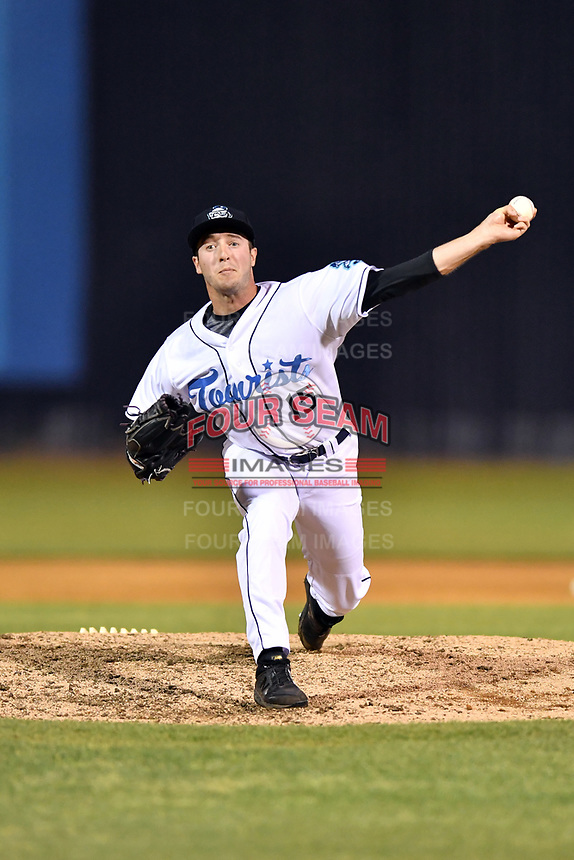 Asheville Tourists pitcher PJ Poulin (15) delivers a pitch during a game against the Hagerstown Suns at McCormick Field on April 30, 2019 in Asheville, North Carolina. The Tourists defeated the Suns 5-4. (Tony Farlow/Four Seam Images)