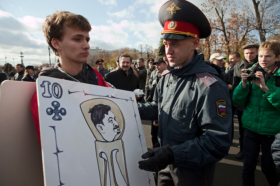 """Moscow, Russia, 22/10/2011..Police arrest counter-demonstrators distributing playing cards mocking organisers at a Russian nationalist protest """"""""Stop Feeding The Caucasus"""" against the alleged over-subsidisation of the North Caucasus region, including Chechnya, by the central Russian government. The campaign has been organised by the Russian Public Movement and the Russian Civil Union, who have joined under the common banner of The Russian Platform."""