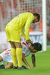 Villarreal's Dos Santos aid Sevilla's Tremoulinas during the match between Sevilla FC and Villarreal day 9 spanish  BBVA League 2014-2015 day 5, played at Sanchez Pizjuan stadium in Seville, Spain. (PHOTO: CARLOS BOUZA / BOUZA PRESS / ALTER PHOTOS)