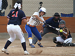 Wildcats' Melanie Mecham hits against Snow College at Edmonds Sports Complex in Carson City, Nev., on Friday, March 20, 2015. <br /> Photo by Cathleen Allison