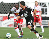 Jaime Moreno #99 of D.C. United looks up to make a pass in front of Tony Tchani #23 of the New York Red Bulls during an MLS match on May 1 2010, at RFK Stadium in Washington D.C.